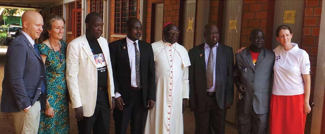 Filippo Campo, Dominique Corti, Dr. Cyprian Opira, Dr. Martin Ogwang, Archbishop J.B. Odama, Dr. Emintone Odong, Pier Paul Ocaya & Sarah McGee.